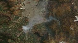 Imagen satelital de las 10:30 am del 19 de enero de 2016 sobre Santiago. Fuente: https://worldview.earthdata.nasa.gov